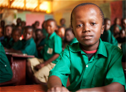 CURE Hydrocephalus patient Tom, sitting in school with his peers.