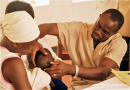 CURE Hydrocephalus patient Tom, with his mom after being healed.
